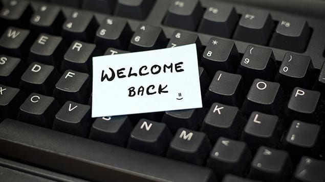 Image of a keyboard with welcome back written on it