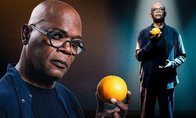 Samuel L Jackson holding an orange