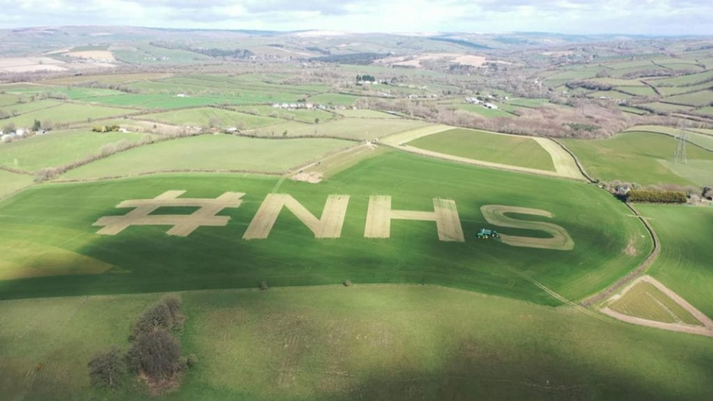 Farmer mows NHS in to his field to show support